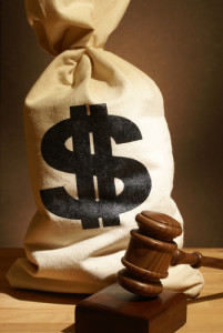 Photo credit: A bag of money and gavel represent many legal expenses // ShutterStock