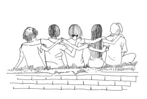 Photo credit: friends embracing each other sitting on the ground // ShutterStock