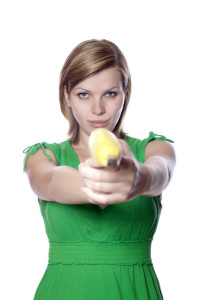 You might be amazed by how many photos of women using bananas as guns are in the ShutterStock database. Photo credit: Pretty girl in a green dress is holding a banana as a gun // ShutterStock