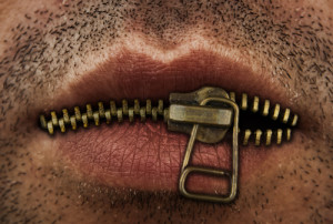 Photo credit: man's mouth with bronze or gold metal zipper // ShutterStock