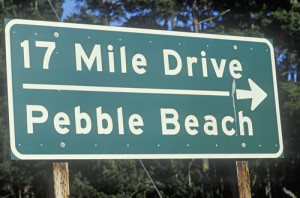 Did you know it costs $10 to drive this famous stretch of road? Photo credit: 17 Mile Drive scenic drive sign in Pacific Grove, California // ShutterStock