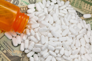 Photo credit: Painkiller, prescription drugs, money // ShutterStock