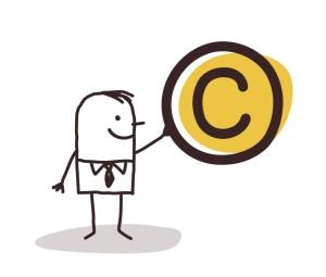 shutterstock / NLshop - man holding copyright symbol