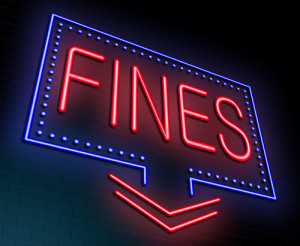 "Photo credit: ""an illuminated neon sign with a fines concept"" // ShutterStock"