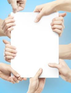 Photo credit: many hands holding paper poster // ShutterStock