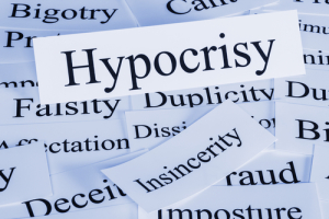 Photo credit: a conceptual look at hypocrisy, insincerity, cant, bigotry, imposture, duplicity // ShutterStock