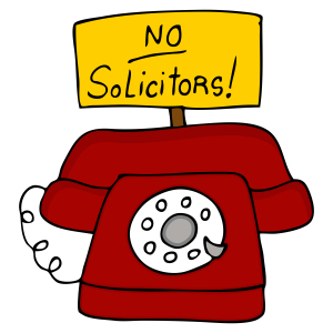 an image of a telephone with a no solicitors sign