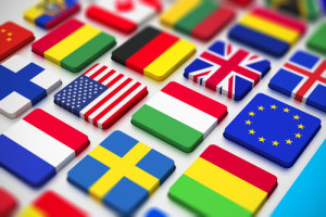 """Photo credit: """"close macro view of computer PC keyboard from colorful world countries flags"""" // ShutterStock"""