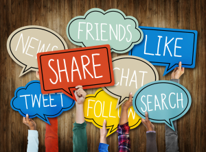 """shutterstock/rawpixel """"hands holding bubbles with social media words"""""""