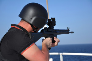 "Photo credit: ""armed guard on board sea going vessel in aden gulf"" // ShutterStock"