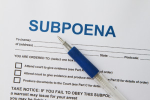 Photo credit: Close up picture of Subpoena with pen // ShutterStock