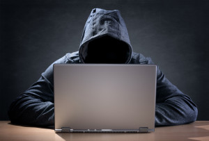 Shutterstock / Brian A. Jackson - Computer hacker stealing data from a laptop concept for network security, identity theft and computer crime