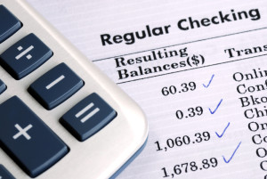 "Photo credit: ""Check the bank statement and balance the account"" // ShutterStock"