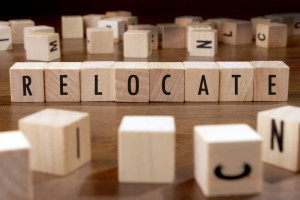 Photo credit: RELOCATE word written on wood block // ShutterStock