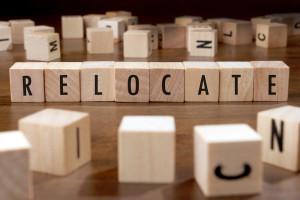 Photo credit: RELOCATE word written on wood block // ShutterStock