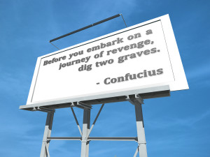 "Photo credit: ""A Billboard with Before you embark on a journey of revenge, dig two graves"" // ShutterStock"