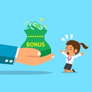 shutter stock / jaak - business big hand giving bonus money to business woman